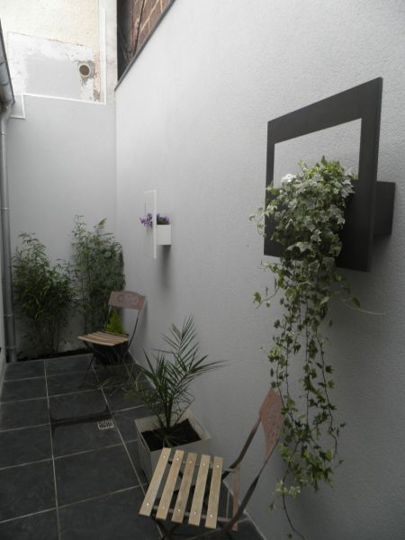 Le patio dernier am nagement en date martin judith for Amenagement patio